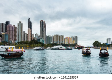 Sampan ride is a popular tourist activity to explore Aberdeen habour and the floating village where people live on house boats. Aberdeen, Hong Kong Island, Hong Kong, January 2018
