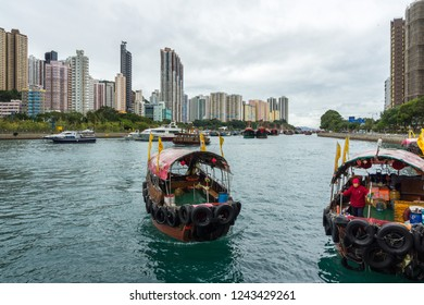 Sampan ride is a popular tourist activity to explore Aberdeen habor and the floating village where people live on house boats. Aberdeen, Hong Kong Island, Hong Kong, January 2018