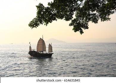 Sampan Sailing in Victoria Harbor, Hong Kong