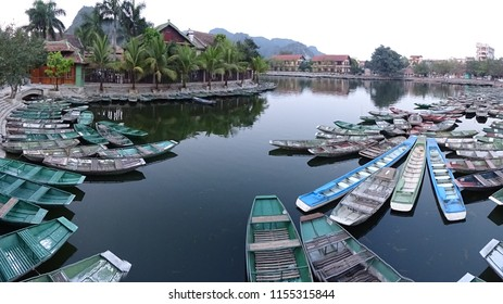 sampans, traditional vietnamese rowing boats at van lam pier, starting point of tam coc boat ride, famouse attraction in Tam Coc (also known as Halong Bay of rice fields)  Vietnam