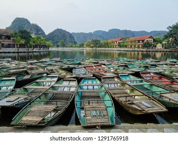 sampans, traditional wooden boats from Vietnam, docking at Tam Coc boats station, boat ride with beautiful natural scenery is known as Halong Bay on Land, 6 km from Ninh Binh, 80 km south of Hanoi