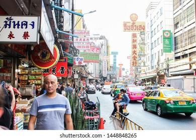 Samphanthawong District, Bangkok, Thailand - March 15, 2017 :  The image of Yaowarat Road, the main artery of Bangkok's Chinatown, in cloudy sky.