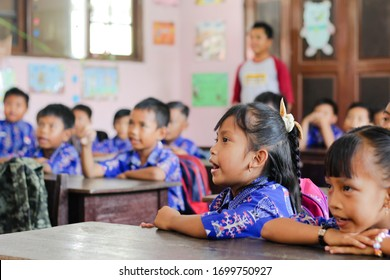 Sampit, Kotawaringin Timur, Central Kalimantan, Indonesia - April 25, 2018 : Students wearing uniform scholl learning together at the classroom. Each student records what the teacher taught.