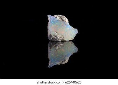 Sample of a beautiful Opal  speciment isolated on black background