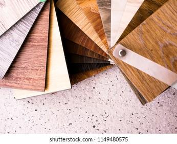 Sample catalog stack of luxury vinyl floor tile for new home or floor renovation interior design