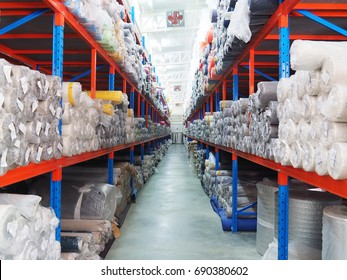 Sample fabric rolls in warehouse