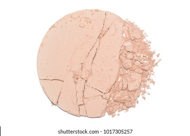 A sample of face powder in white. Beige round cracked powder palette. Decorative cosmetic product