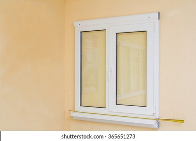 Sample of manufactured plastic UPVC window on the wall, ready to install