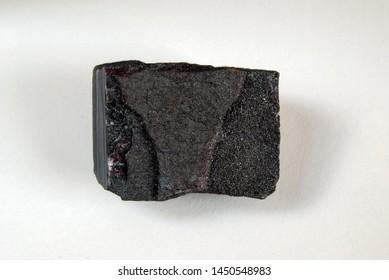 A sample of metamorphic rocks is jaspilite, jaspilite, ferruginous quartzite, and mineral zhespillit. Passage: Kursk Magnetic Anomaly, Mikhailovskoye, Russia.