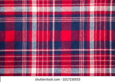 Sample of red tartan textile; Checked fabrics