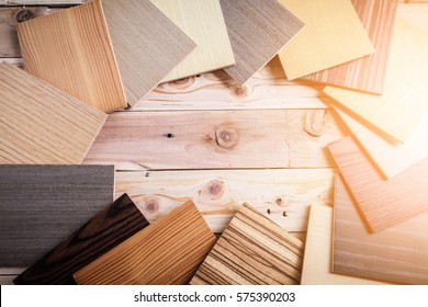 sample of wood laminate material on wooden background with free copyspace