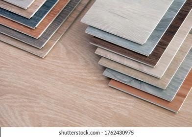 sample of wood material color. wood surface texture.  multi color vinyl floor tile. veneer, laminate, polywood.