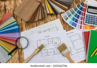 Samplers for decorating and house plan on desk