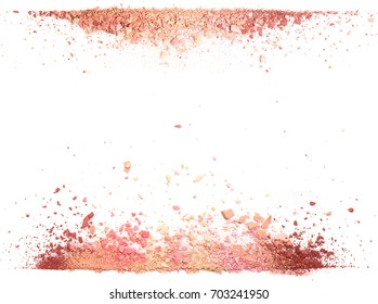 Samples of dry blush, powder, bronzers and highlighter scattered in a line isolated on a white background