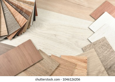 Samples of laminate and vinyl floor on wooden Background.Wood texture floor :oak  maple , chestnut , walnut , balsam tile,