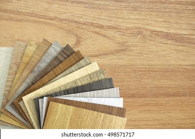 Samples of laminate and vinyl floor tile on wooden Background.Wood texture floor :oak tile, maple tile, chestnut tile, walnut tile, balsam tile,