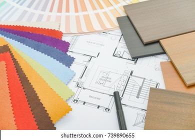 Samples of material and drawing on working table of designer