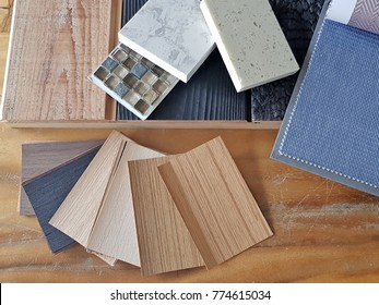 samples of material, wood , color , fabric curtain ,ceramic , on wooden table.Interior design select material for idea.