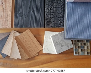 samples of material, wood , color ,   , on wooden table.Interior design select material for idea.