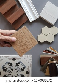 samples of material, wood , on concrete table.Interior design select material for idea. Decoration idea concept vintage material.