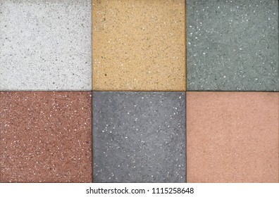 Samples of outdoor floor tiles of different colors. Artificial stone.
