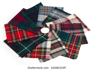 Samples of Tartan cloth arranged into a camera aperture leaf like formation. Scottish traditional cloth used for kilts and clothes.