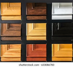 Samples of wooden panels for furniture and door on black surface