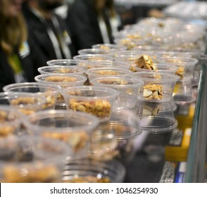 Sampling Granola Bars at Trade Show