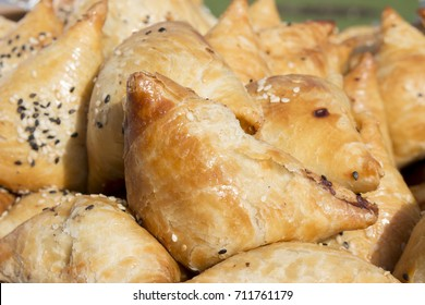 Samsa - patties of a triangular shape in Uzbek and Tajik cuisines, often with a filling of chopped meat and onions.