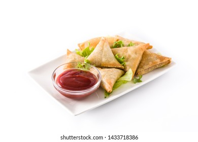 Samsa or samosas with meat and vegetables isolated on white background . Traditional Indian food. Copyspace