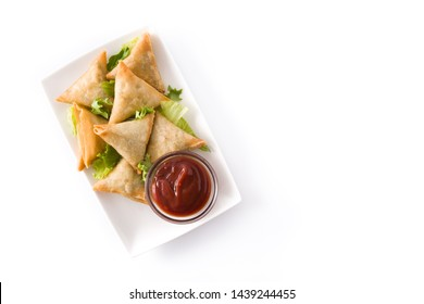 Samsa or samosas with meat and vegetables isolated on white background . Traditional Indian food. Top view. Copyspace
