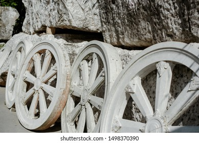 Samsara stone wheels carved from white marmore in a Thai Buddhist temple.