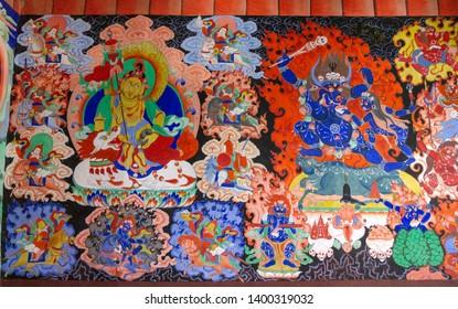 Samstanling, India - June 23, 2012: Dharmapala wrathful deity colorful wall painting, spiritual and ritual symbol of Buddhism, in Samstanling monastery, Nubra, Ladakh, India