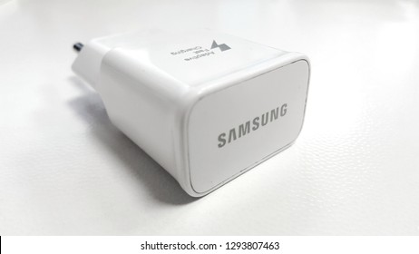 Samsung battery charger in white background. Samsung device