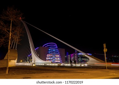 Samuel Beckett bridge in Dublin at night. Convention center in background