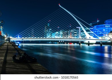 Samuel Beckett Bridge at night by the architect is Santiago Calatrava, is a cable-stayed bridge in Dublin crossing the River Liffey in the Docklands area. Dublin, Ireland