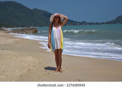Samui island Thailand October 2018: Beautiful lady in a bright dress on Samui Island Lamai beach on a sunny day.