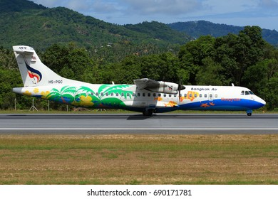 Samui Island-THAILAND, 24 MAY 12: ATR72-500 Turboprop (HS-PGC) of Bangkok Airways (a domestic-regional airlines) as seen taking at Samui Airport on a sunny day with beautiful natural background.