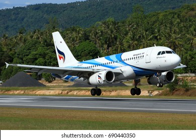 Samui Island-THAILAND, 24 MAY 12: Airbus A319-100 (HS-PGT) of Bangkok Airways (a domestic-regional airlines) as seen landing at Samui Airport on a sunny day with beautiful natural background.