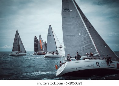 SAMUI - MARCH 1,2017 : Regatta yacht sailing race in Samui island, Surat Thani - Thailand. The most famous yacht sailing event in the world. Film vintage process.