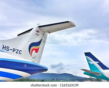 Samui, Thailand, 24 August,2018 ; Bangkok Airways ATR72-600 REG HS-PZC and SilkAir Airbus A319 REG 9W-SBH at Samui airport.