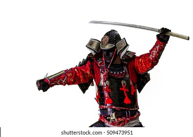 Samurai in ancient armor, with a sword ready to attack close-up