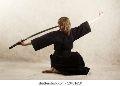 samurai with blade sits