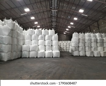 Samut Prakan, Thailand -  6 August 2020 Large jumbo hemp sack White, packed with chemical fertilizer, rice, sugar, placed on a wooden pallet waiting to be delivered to the customer