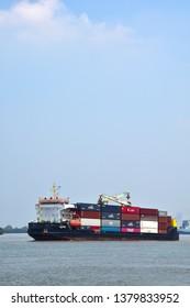 SAMUT PRAKAN, THAILAND. April 21, 2019: Container ship moving by Chao Phraya river at Phra Pradaeng,Samut Prakan