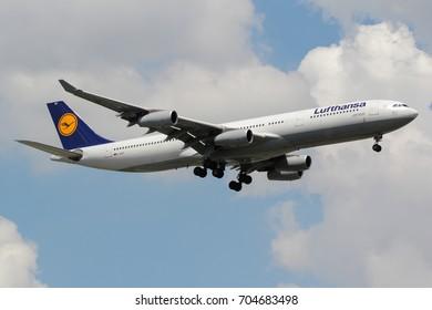 Samut Prakan, Thailand. August 11, 2017. Lufthansa Airbus A340-300 Reg. D-AIGS from German on Short Final for Landing at Suvarnabhumi International Airport with Cloud Blue Sky.