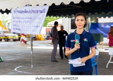 SAMUT PRAKAN, THAILAND, AUGUST 7, 2016 : A TV reporter woman is talking holding her microphone in The referendum Draft Constitution of 2016 by the military government.
