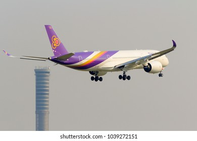 Samut Prakan, Thailand. February 17, 2018. Thai Airways International Airbus A350 Approaching for Landing at Suvarnabhumi International Airport with Air Traffic Control Tower (ATC) Background.