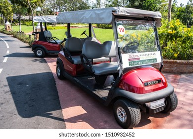 Samut Prakan, Thailand -February16, 2016: View of red traveling golf cart  parks at Ancient City or Ancient Siam or Mueang Boran, outdoor park museum featuring replicas historic buildings of Thailand.