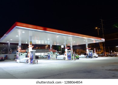Samut prakan, Thailand - Jan 18, 2019: ESSO (Exxon Mobil) gas station at night background. Esso gas station. Esso a trading name for Exxon Mobil, an American multinational oil and gas corporation.